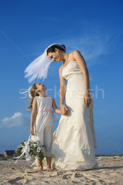 Bride and Flower Girl on Beach Stock photo © iofoto
