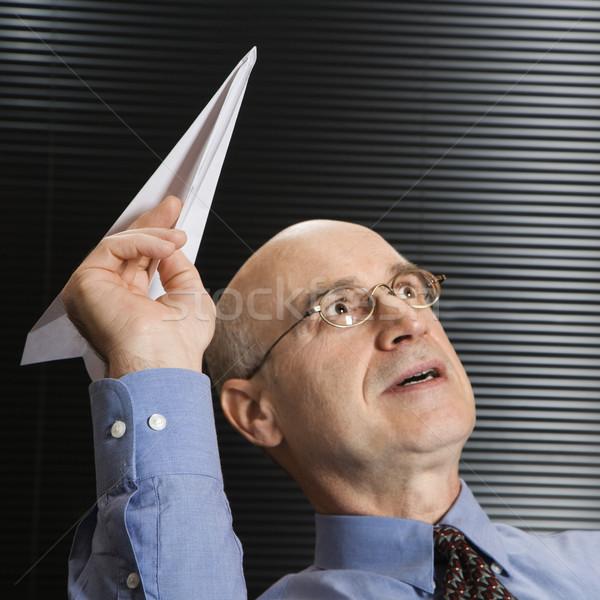 Biznesmen gry papierowy samolot człowiek Zdjęcia stock © iofoto