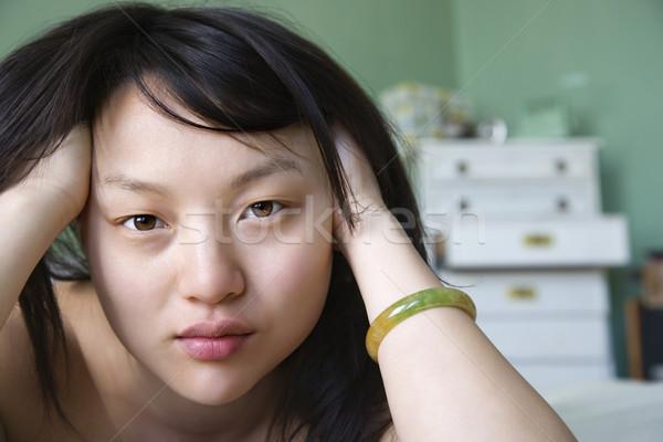 Güzel genç Asya kadın yatak Stok fotoğraf © iofoto