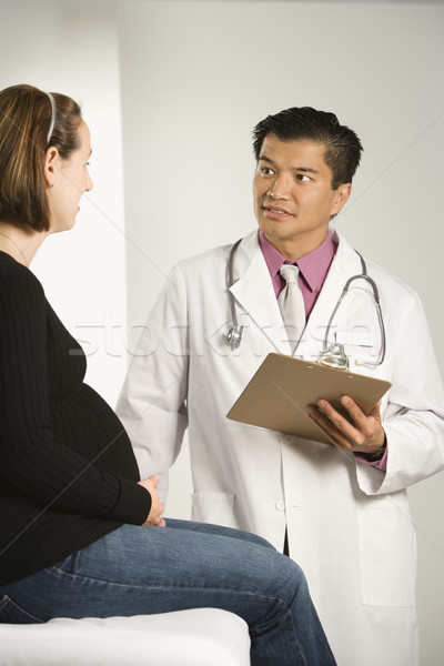 Doctor examining pregnant woman. Stock photo © iofoto