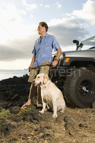 Man and Dog by SUV at the Beach Stock photo © iofoto