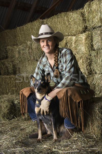 Attrattivo indossare cappello da cowboy bianco seduta Foto d'archivio © iofoto