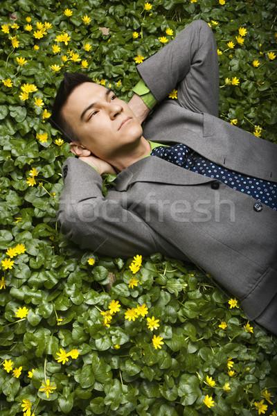 üzletember virág folt fiatal megnyugtató gondolkodik Stock fotó © iofoto