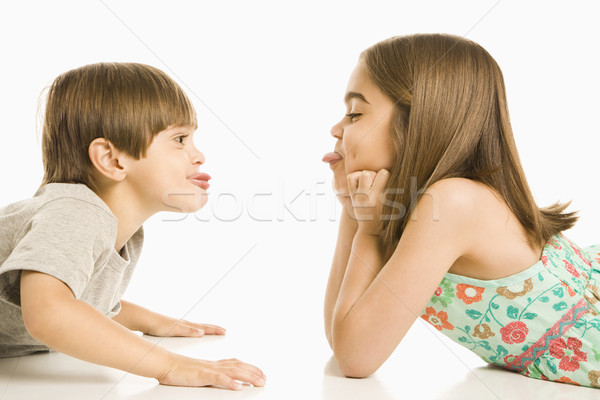 Children sticking out tongues. Stock photo © iofoto