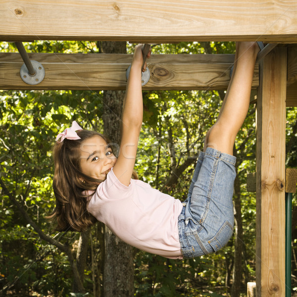 Girl on monkey bars. Stock photo © iofoto