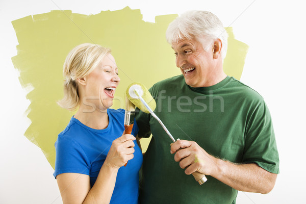 Man and woman relaxing while painting. Stock photo © iofoto