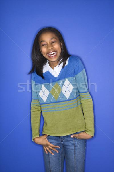 Portré mosolyog lány kezek áll kék Stock fotó © iofoto
