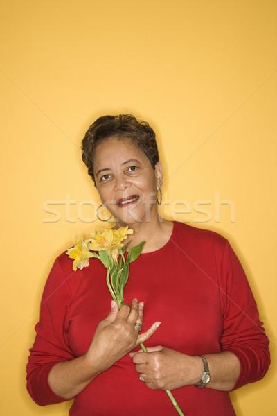 Woman holding flowers. Stock photo © iofoto