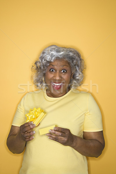 Woman opening gift box. Stock photo © iofoto