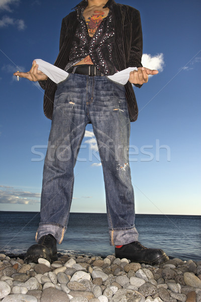 Young Man at Beach with Empty Pockets Stock photo © iofoto