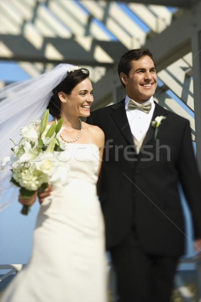 Menyasszony vőlegény sétál kaukázusi együtt mosolyog Stock fotó © iofoto