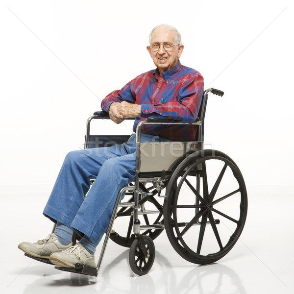 Elderly man in wheelchair. Stock photo © iofoto
