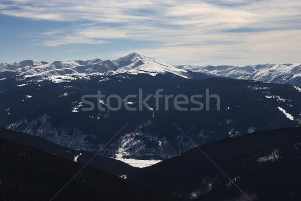Snowy mountains and valley. Stock photo © iofoto
