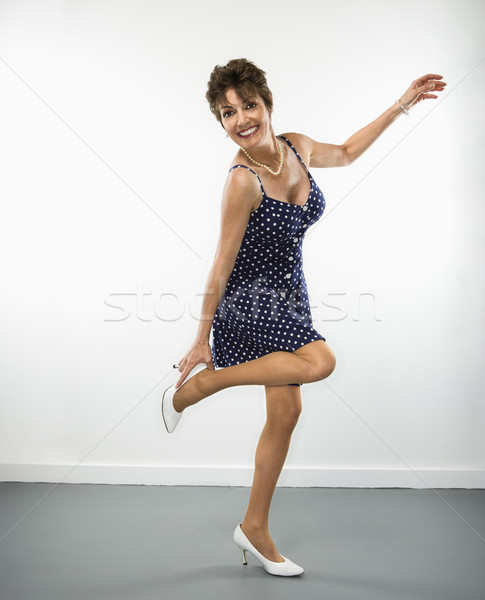Femme joli à pois robe Photo stock © iofoto