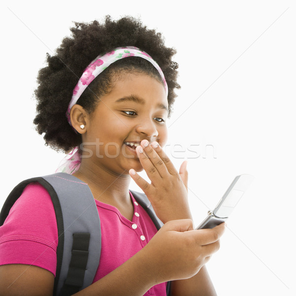 Girl with cell phone. Stock photo © iofoto