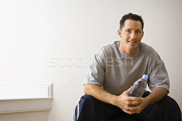 Férfi tornaterem portré tart vizes flakon ül Stock fotó © iofoto