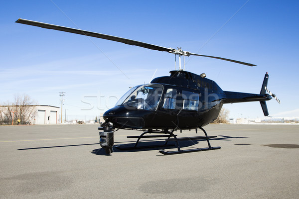 Helicopter parked at airport lot. Stock photo © iofoto