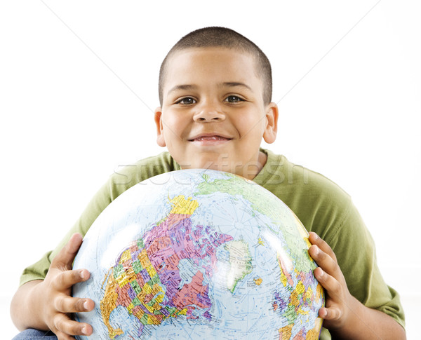 Smiling young hispanic boy with globe Stock photo © iofoto