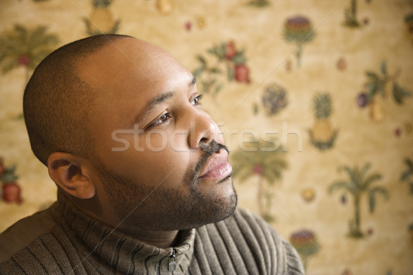 Young Man with Thoughtful Gaze Stock photo © iofoto