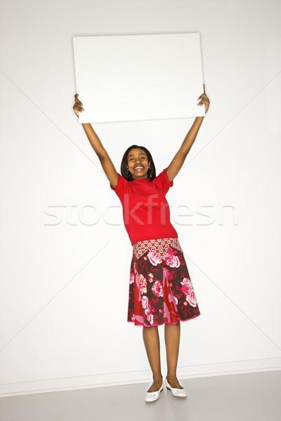Lány tart üres tábla portré tinilány fehér Stock fotó © iofoto