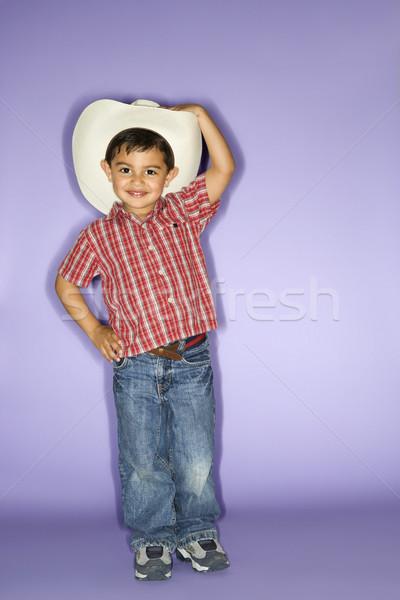Boy wearing cowboy hat. Stock photo © iofoto