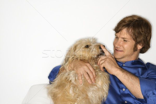 Man with fluffy brown dog. Stock photo © iofoto
