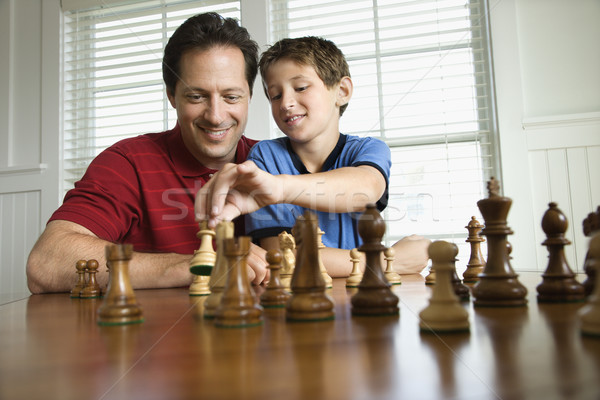 Dad teaching chess to son. Stock photo © iofoto