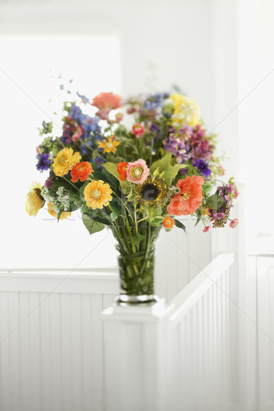 Colorful flowers arranged in vase. Stock photo © iofoto