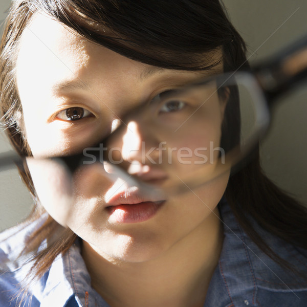 Young woman with eyeglasses. Stock photo © iofoto