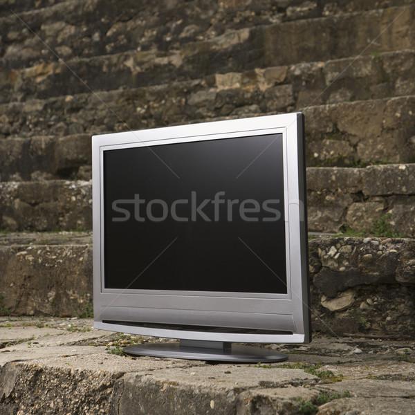 Television by brick wall. Stock photo © iofoto