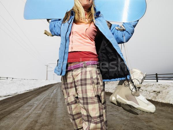 Nő tart hódeszka fiatal nő tél ruházat Stock fotó © iofoto