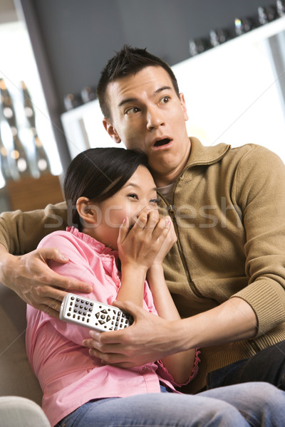 Couple regarder tv asian Homme peur Photo stock © iofoto