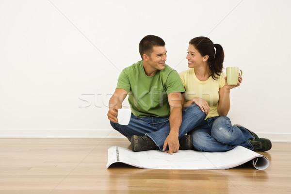 Pár vonzó ül otthon padló kávéscsészék Stock fotó © iofoto