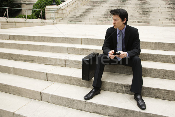 Businessman sitting on steps. Stock photo © iofoto