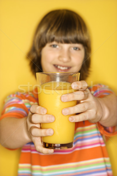 Boy holding orange juice. Stock photo © iofoto