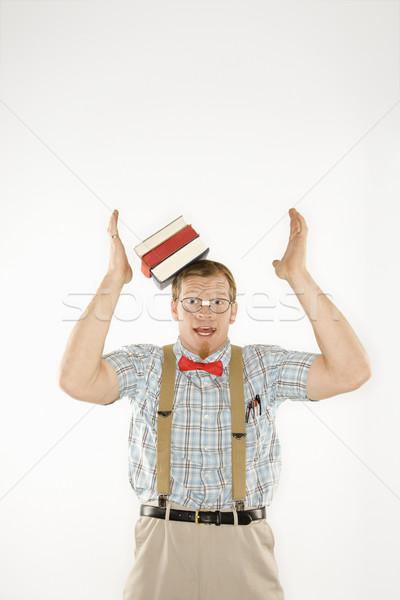 Man dropping books. Stock photo © iofoto