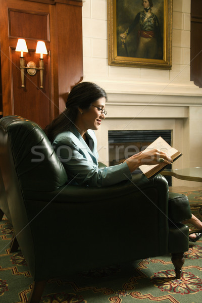 Woman sitting and reading. Stock photo © iofoto