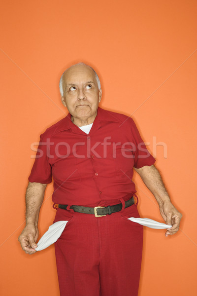 Man with empty pockets. Stock photo © iofoto