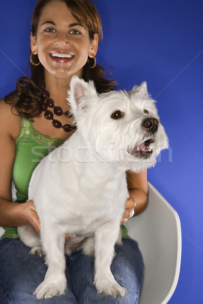 Woman holding white terrier dog. Stock photo © iofoto
