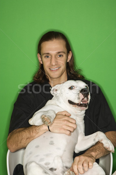 Man holding white dog. Stock photo © iofoto