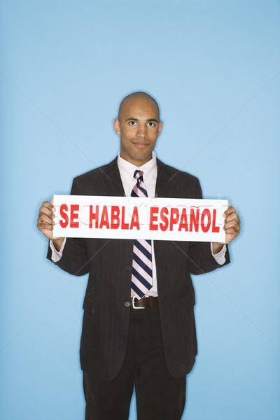 Businessman holding sign. Stock photo © iofoto