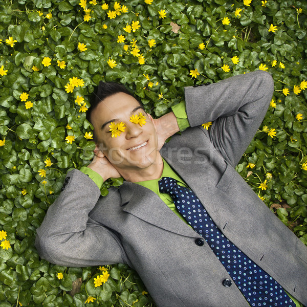 Stock photo: Smiling Businessman in Flower Patch