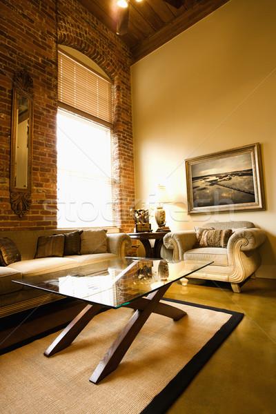 Soggiorno interni finestra muro di mattoni tavolino da caffè Foto d'archivio © iofoto