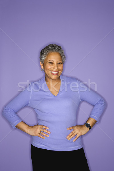Woman standing and smiling. Stock photo © iofoto