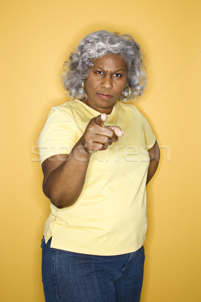 Nő mutat afroamerikai női középkorú felnőtt áll Stock fotó © iofoto