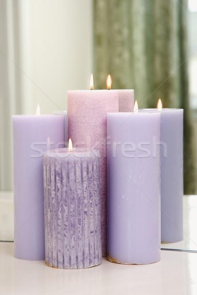 Pourpre bougies brûlant groupe miroir Photo stock © iofoto