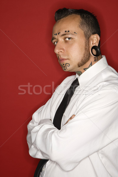 Tattooed man wearing shirt and tie. Stock photo © iofoto