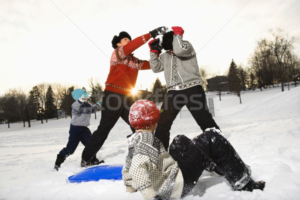 Famille jouer neige quatre Photo stock © iofoto