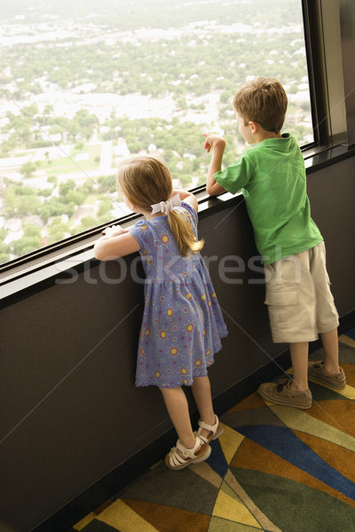 Young kids at window. Stock photo © iofoto