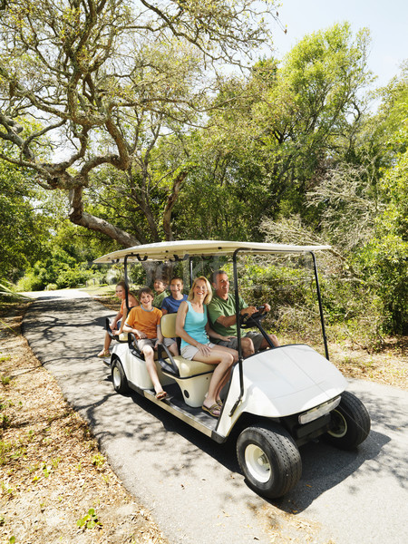 Famiglia golf cart equitazione percorso Foto d'archivio © iofoto